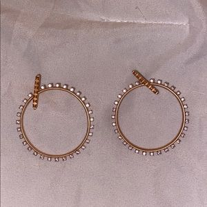 Rose gold hoop style earrings